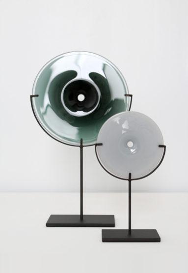 from left: small/smoke 21″H x 12″W (53x30cm), mini/gray 12.5″H x 7″W (32x18cm), both shown w/ dark oxidized steel stand